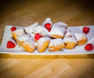 New Orleans popular fried doughnuts layered with powdered sugar.